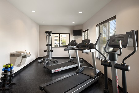 Hotel fitness centre with two treadmills and free weights