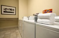Washers and dryers with towels folded on top