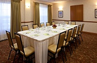 Boardroom-style meeting space in Calgary hotel