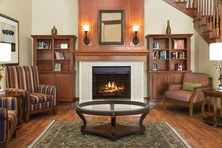 Bookshelves flanking a stately fireplace in our hotel lobby