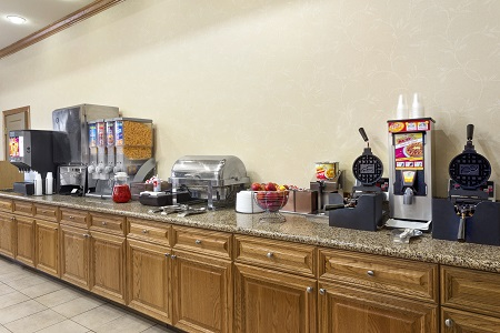 Breakfast bar with cereals and waffle makers