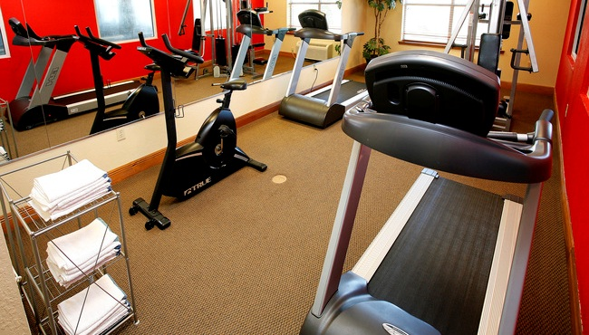 Fitness center with cardio machines and fresh towels