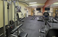 Fitness center with weight machine and treadmill