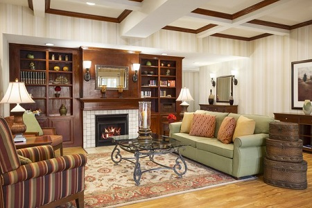 Lobby with fireplace, couch and chairs