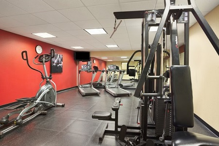 Fitness center with elliptical and weight machine