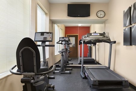 Fitness center with treadmill and stationary bike