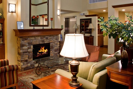 Lobby with a fireplace, couch and armchairs