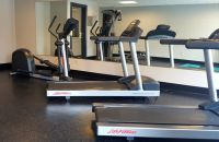 Fitness center with two treadmills and an elliptical