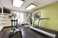 Cardio equipment and TV in hotel fitness center