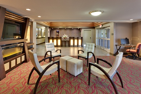 Lobby with TV and modern chairs