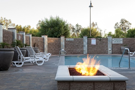 Fire pit by the outdoor pool