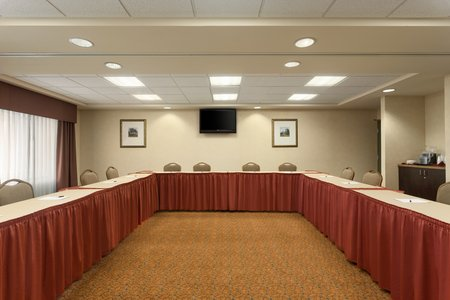 On-site meeting room with tables and chairs