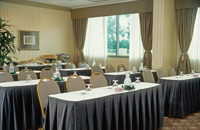 Stylish table settings in San Diego meeting room