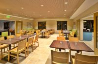 Dining room with ample seating and bright lighting
