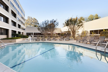 Outdoor pool with patio seating at Sunnyvale hotel