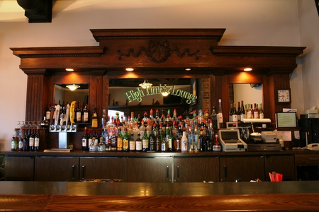 Bar stocked with various liquors and wines at High Timber Lounge
