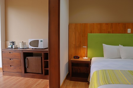Hotel room with bed, microwave and coffee facilities