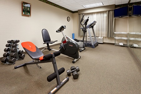 Exercise machines and free weights in the fitness room