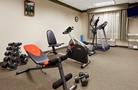 Exercise machines and free weights