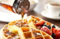 Buttery waffles with syrup and fresh fruit