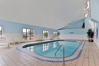 Large indoor pool area with a slanted ceiling