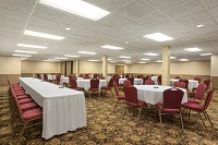Banquet hall with a head table and multiple round tables