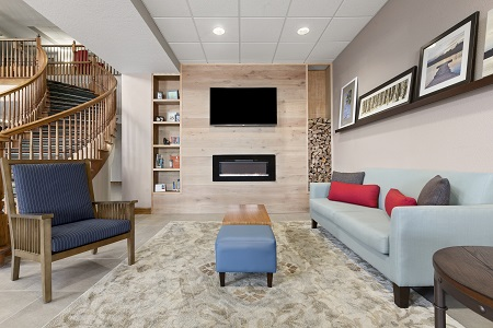Lobby with fireplace and TV hanging above it