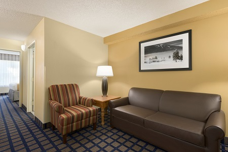 Lake City, Florida hotel room with sofa and chair