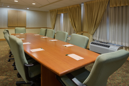 Boardroom with long table surrounded by chairs