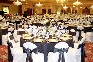 Ballroom decorated with tables and chairs in black and white