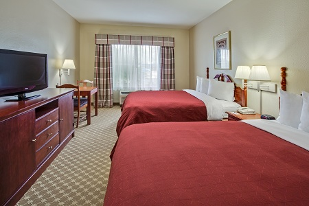 Orlando hotel room with two queen beds and flat-screen TV