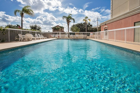 Blue skies over a sparkling outdoor pool in Orlando, FL