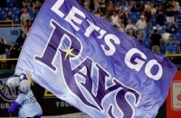 Tampa Bay Rays mascot carrying flag across a sports field