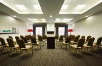 Meeting room with chairs facing a projector screen