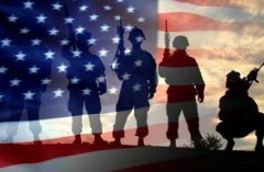 Silhouettes of soldiers in front of the American flag