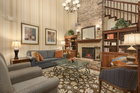 Spacious lobby with fireplace and seating in Seffner