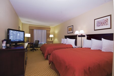 Hotel room with two queen beds, TV and desk