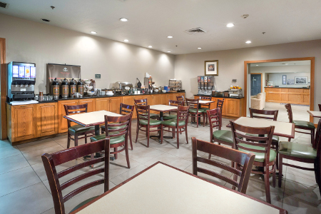 Tables and chairs in breakfast area at Augusta hotel