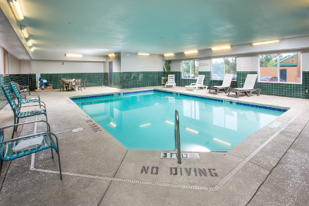 Rectangular pool with blue-green water at Augusta hotel