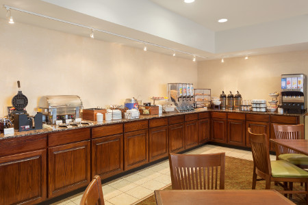 Columbus hotel's dining area with waffle maker and juice dispenser