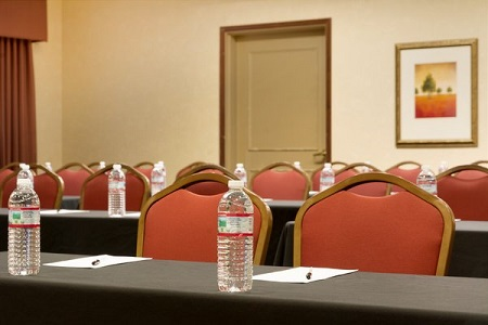 Hotel's meeting room with bottled water, notepads and pens