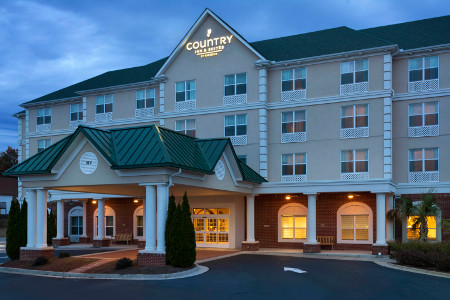 Country Inn Suites Braselton Ga Hotel Exterior Lit Up At Dusk