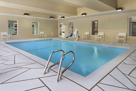 Sparkling Indoor Pool Surrounded By Chairs