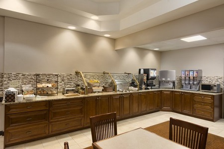 Buford hotel's breakfast area serving pastries and cereal