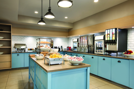 Breakfast bar featuring fresh fruit, hot selections and more