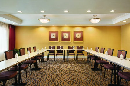 Meeting room with bottled waters and stationery