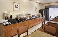 Hotel dining area with seating and breakfast options