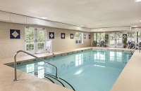 Fairburn hotel's heated indoor pool with natural light and seating