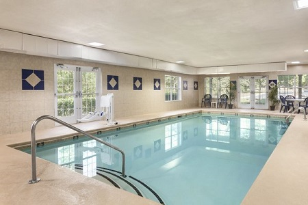 Fairburn hotel's indoor pool with seating area