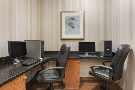 Hotel's business center with two computer stations